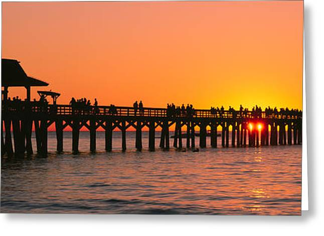 Silhouette Of Huts And A Pier At Dusk Greeting Card by Panoramic Images