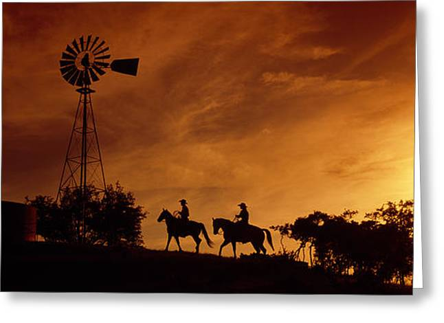 Cowgirl And Cowboy Greeting Cards - Silhouette Of Two Horse Riders Greeting Card by Panoramic Images