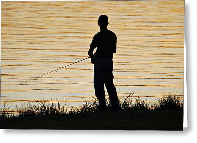 Greeting Card featuring the photograph Silhouetted Fisherman by Teresa Blanton