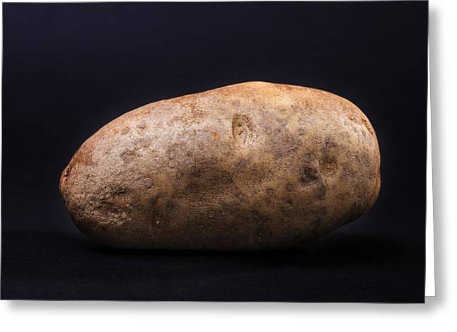 Single Russet Potato On Black  Background Greeting Card