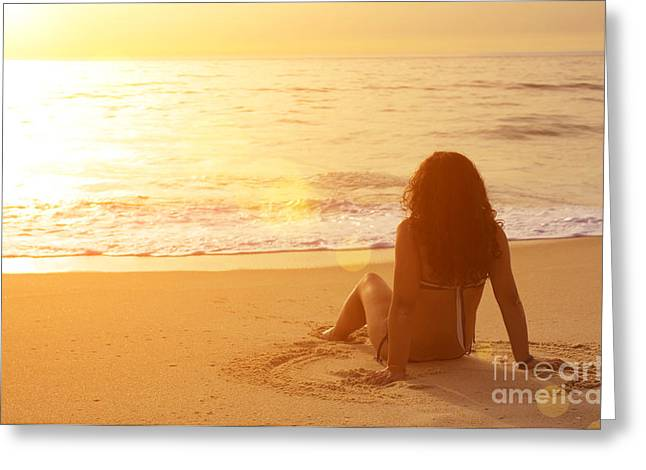 Sitting In The Sand Greeting Card by Carlos Caetano