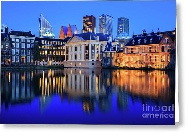 Greeting Card featuring the photograph Skyline Of The Hague At Dusk During Blue Hour by IPics Photography