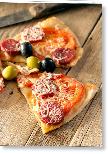 Slices Of Homemade Pizza With Salami Greeting Card by Vadim Goodwill
