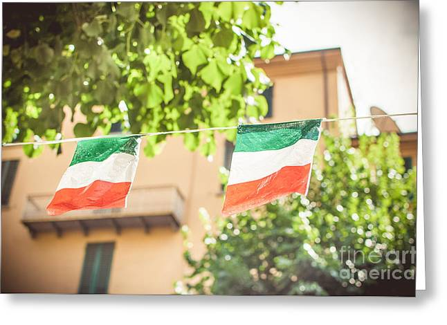 small Italian flags hanging by a thread Greeting Card by Luca Lorenzelli