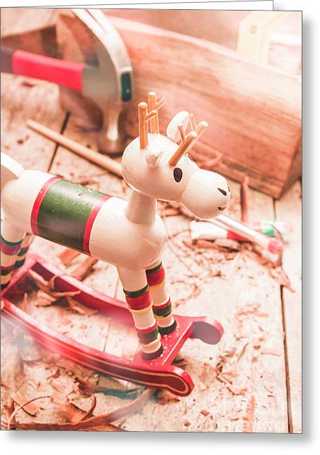 Small Xmas Reindeer On Wood Shavings In Workshop Greeting Card