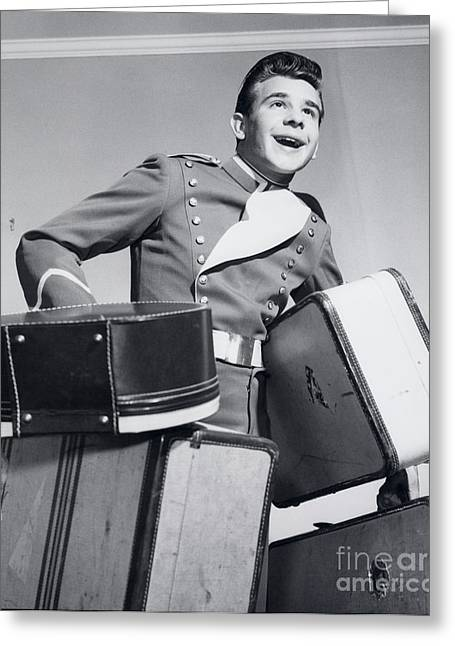 Smiling Bellboy Carrying Luggage Greeting Card