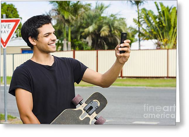 Smiling Skateboarder Man Taking Cell Phone Photo Greeting Card by Jorgo Photography - Wall Art Gallery