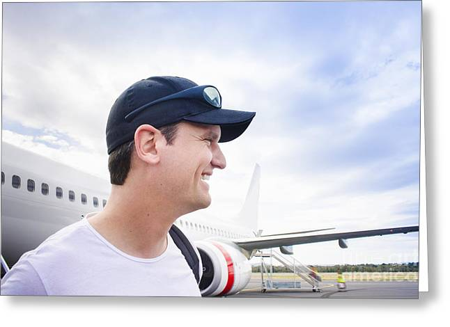 Smiling Travelling Man Standing On Airport Tarmac Greeting Card by Jorgo Photography - Wall Art Gallery