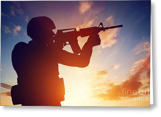 Soldier Shooting With His Rifle At Sunset Greeting Card by Michal Bednarek