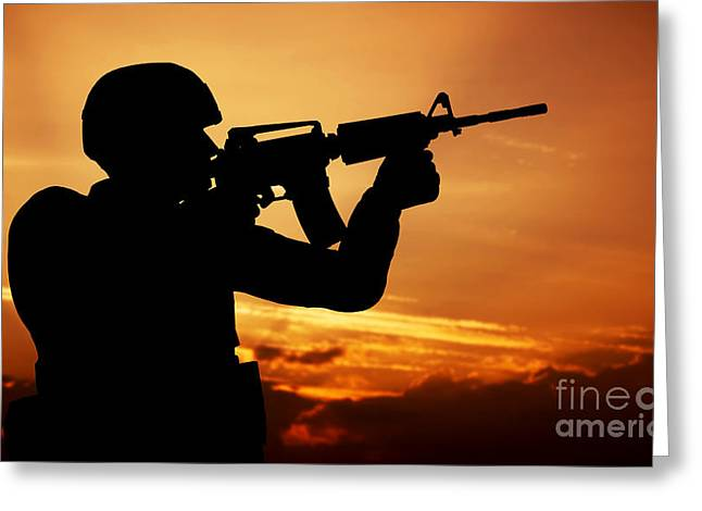 Soldier Shooting With His Weapon At Sunset Greeting Card by Michal Bednarek