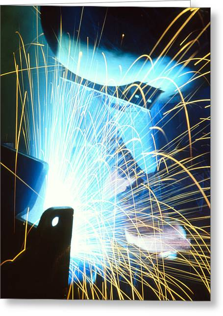 Sparks Flying From An Argon Welder At Work Greeting Card by Chris Knapton