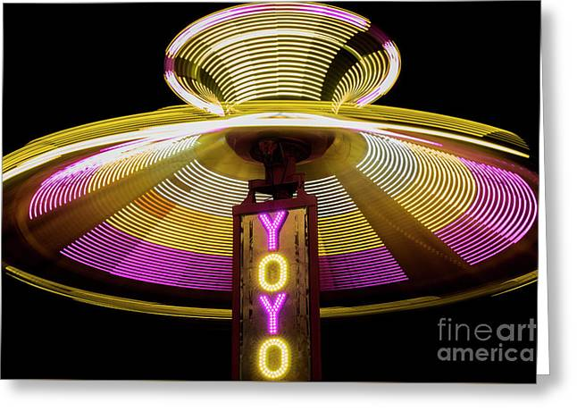 Spinning Yoyo Ride Greeting Card by Juli Scalzi