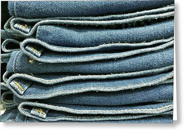 Stack Of Denim  Greeting Card by Tom Gowanlock