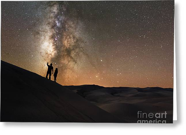 Stargazers Under The Night Sky Greeting Card by Michael Ver Sprill