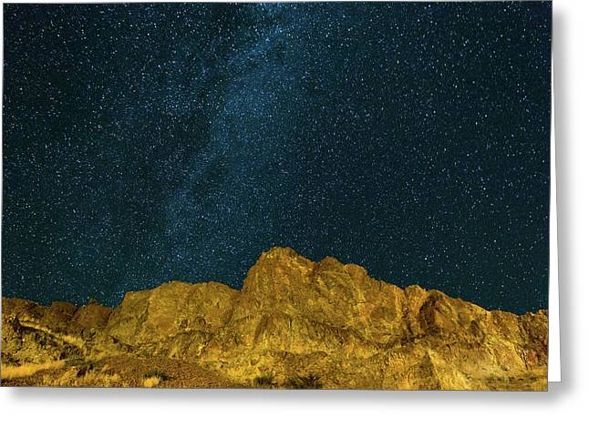 Starry Night Sky Over Rocky Landscape Greeting Card