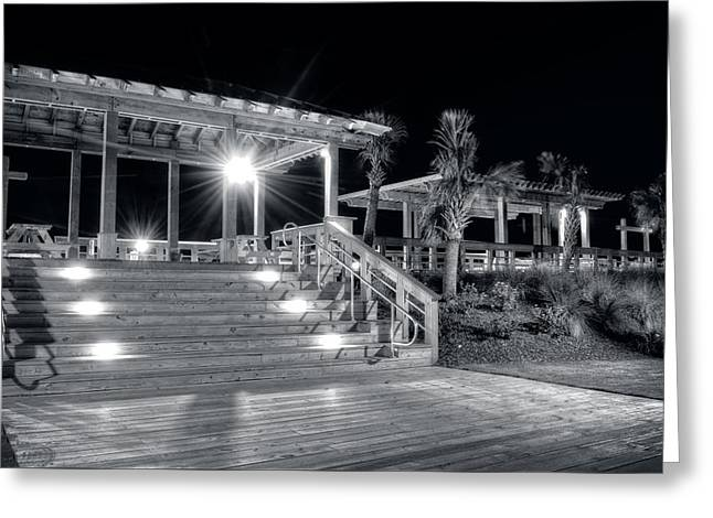 Steps Up To The Carolina Beach Boardwalk At Night In Black And W Greeting Card by Greg Mimbs
