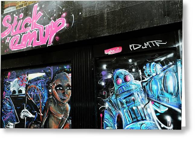 Stick 'em Up Shopfront Graffiti  Greeting Card by Liz Pinchen