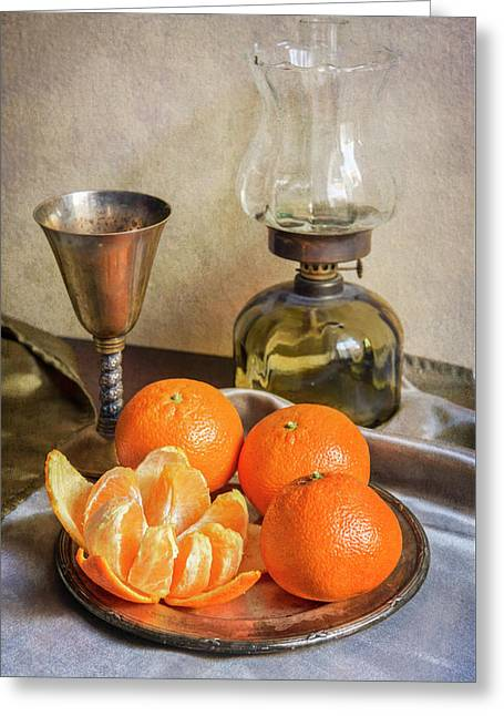 Greeting Card featuring the photograph Still Life With Oil Lamp And Fresh Tangerines by Jaroslaw Blaminsky