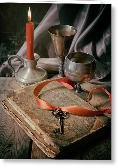 Greeting Card featuring the photograph Still Life With Old Book And Metal Dishes by Jaroslaw Blaminsky