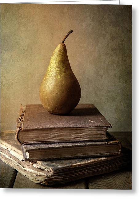 Greeting Card featuring the photograph Still Life With Old Books And Fresh Pear by Jaroslaw Blaminsky