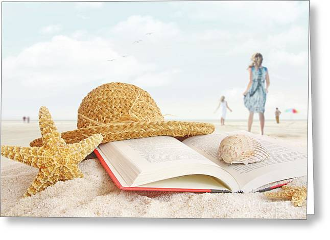 Straw Hat  Book And Seashells In The Sand Greeting Card by Sandra Cunningham