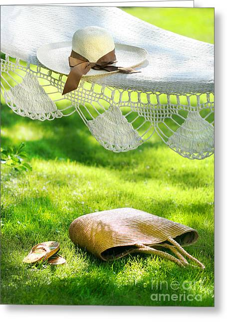 Straw Hat With Brown Ribbon Laying On Hammock Greeting Card by Sandra Cunningham
