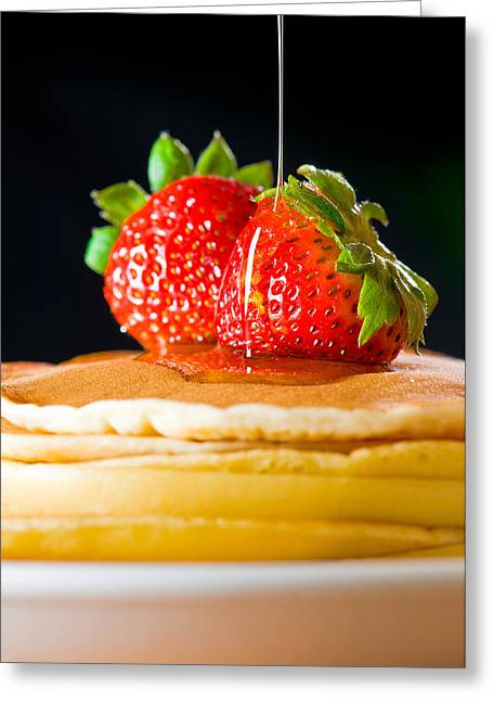 Culinary Photographs Greeting Cards - Strawberry butter pancake with honey maple sirup flowing down Greeting Card by Ulrich Schade