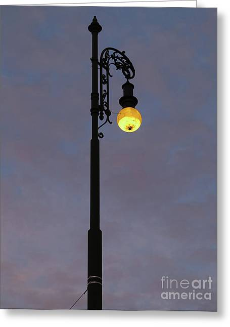 Greeting Card featuring the photograph Street Lamp Shining At Dusk by Michal Boubin