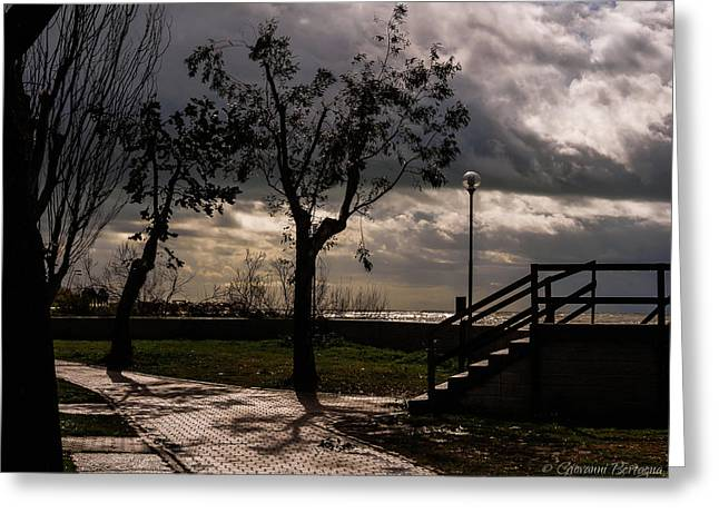 Strolling The Waterfront On A Stormy Day Greeting Card