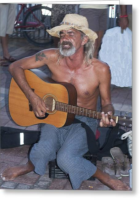 Strumming A Tune In Key West Greeting Card by Carl Purcell