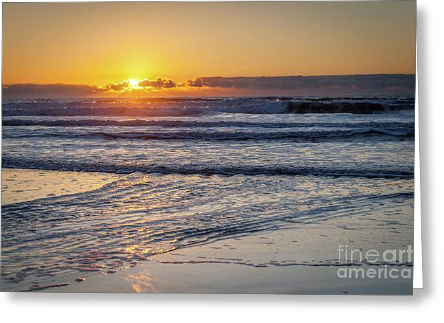 Sun Behind Clouds With Beach And Waves In The Foreground Greeting Card