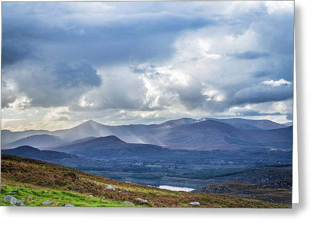 Greeting Card featuring the photograph Sun Rays Piercing Through The Clouds Touching The Irish Landscap by Semmick Photo