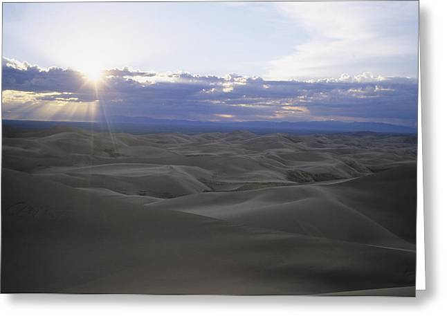 Sun Sets Over Miles Of Sand Dunes Greeting Card by Taylor S. Kennedy