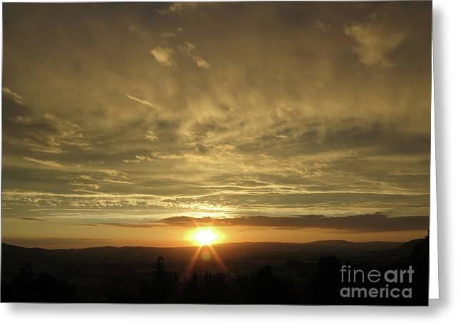 Sun Setting Over The Horizon Greeting Card