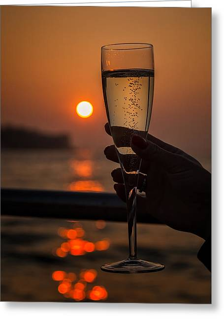 Sun Setting Through A Glass Of Champagne Greeting Card