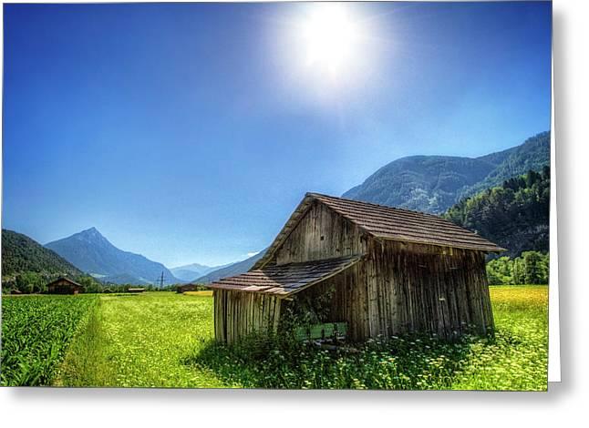 Sunlit Farm In The Alps Greeting Card by Debra and Dave Vanderlaan