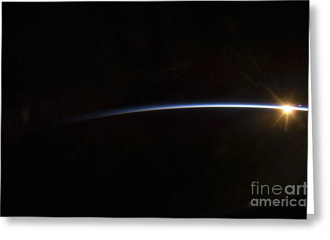 Sunrise As Viewed In Space Greeting Card by Stocktrek Images