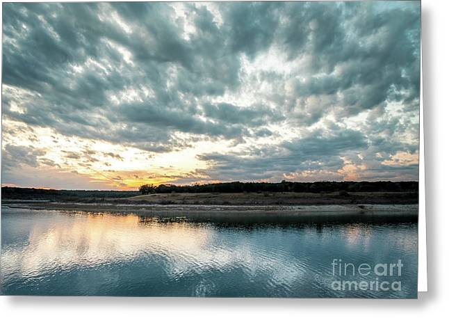 Sunset Behind Small Hill With Storm Clouds In The Sky Greeting Card