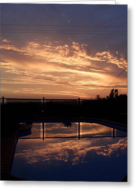 Sunset Over A Pool Greeting Card by Edan Chapman