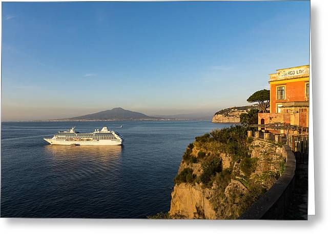 Sunset Postcard From Sorrento - The Sea The Cliffs And Vesuvius Volcano Behind The Criuse Ship Greeting Card by Georgia Mizuleva