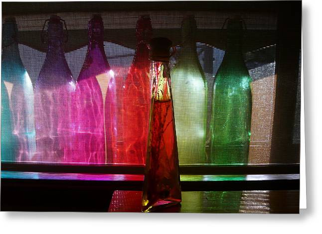 Sunset Through Glass Bottles Greeting Card by Adrianne Wood