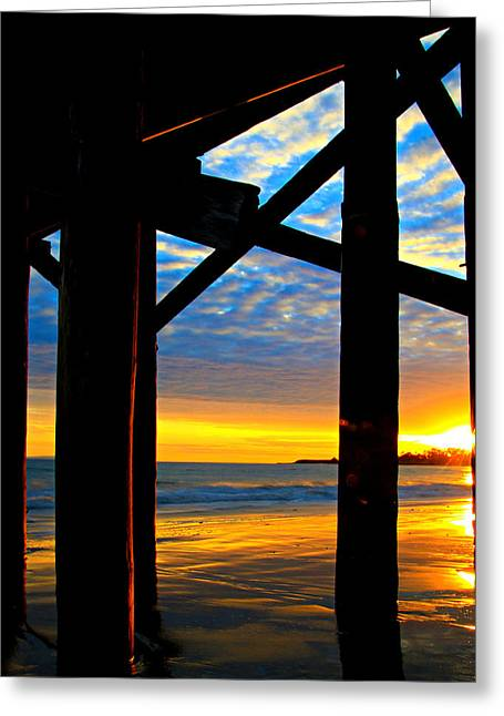 Sunset Through The Pier Greeting Card by Bill Keiran