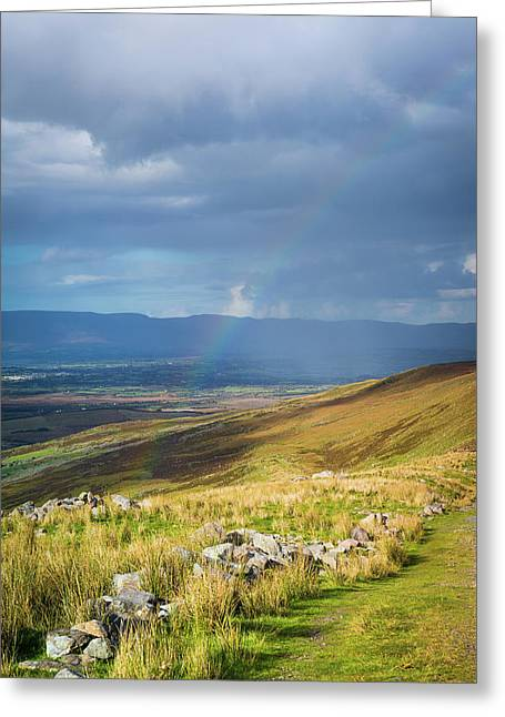 Greeting Card featuring the photograph Sunshine And Raining Down With Rainbow On The Countryside In Ire by Semmick Photo