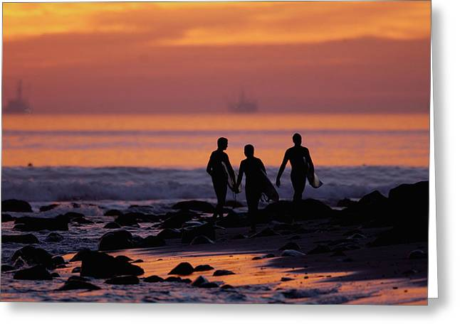 Surfers At Sunset Greeting Card