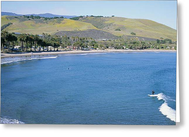 Surfers Ride The Waves At Refugio Beach Greeting Card by Rich Reid