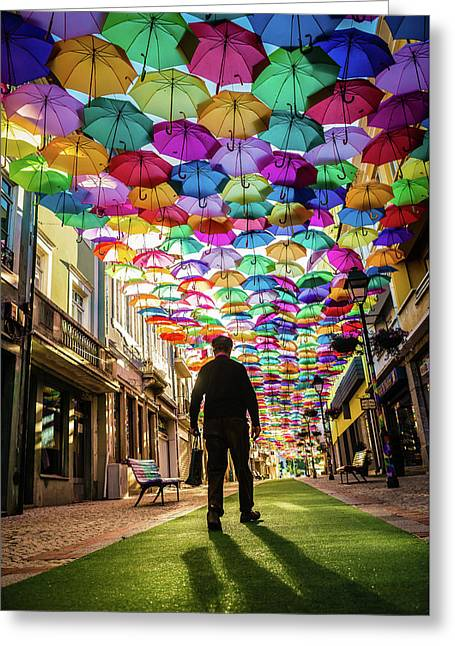 Take A Walk Under The Umbrella Sky Greeting Card by Marco Oliveira
