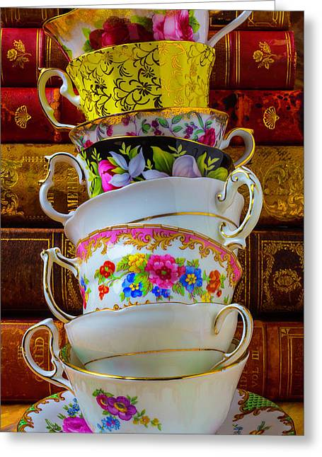 Tea Cups Stacked Against Old Books Greeting Card