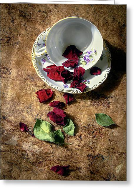 Teacup And Red Rose Petals Greeting Card