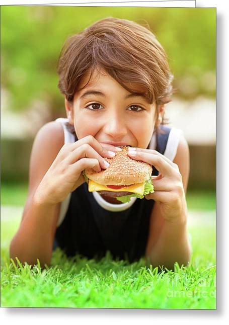 Teen Boy Eating Burger Outdoors Greeting Card by Anna Om