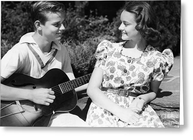 Teen Boy Serenading Girl With Guitar Greeting Card by H. Armstrong Roberts/ClassicStock